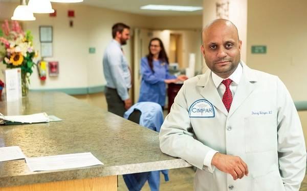 Doctor at Nursing Station